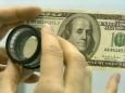 Катасонов: Россию могут наводнить фальшивыми долларам