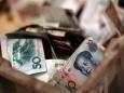 Китай сократил использование доллара в международной торговле на 20%